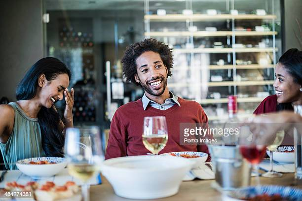 Man telling a joke at dinner party