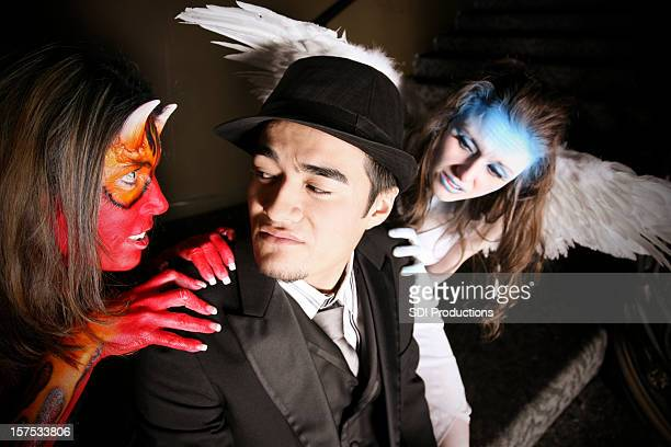 Man tempted by a she-devil and an angel