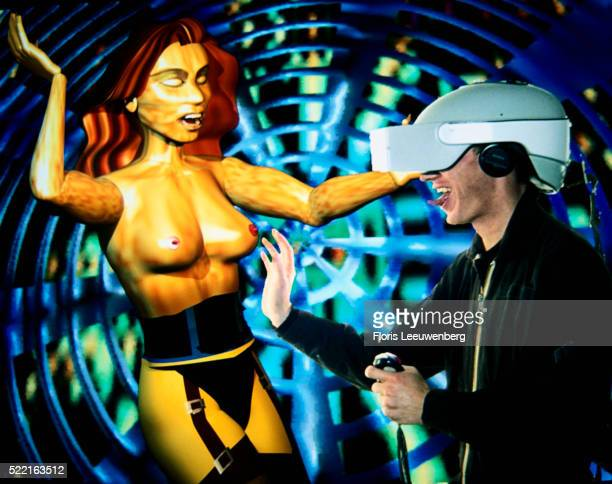 man tempted by virtual woman - girdle stock pictures, royalty-free photos & images