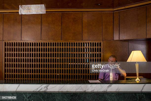 A man tends the reception desk at the closed Imperial Marhaba Hotel on June 24 2016 in Sousse Tunisia The Imperial Marhaba hotel was the main target...