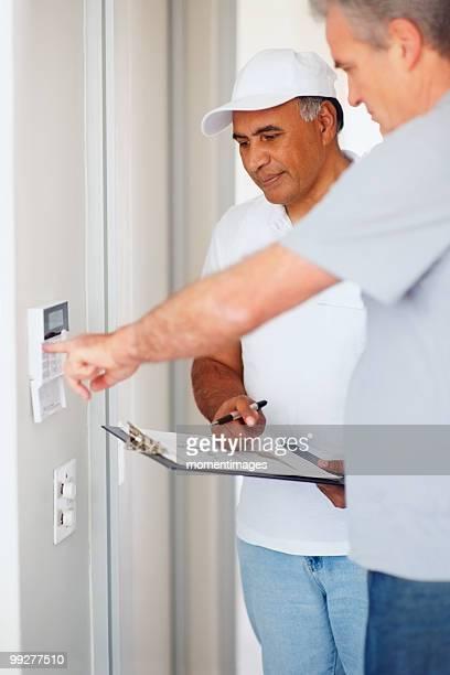 Man testing alarm system