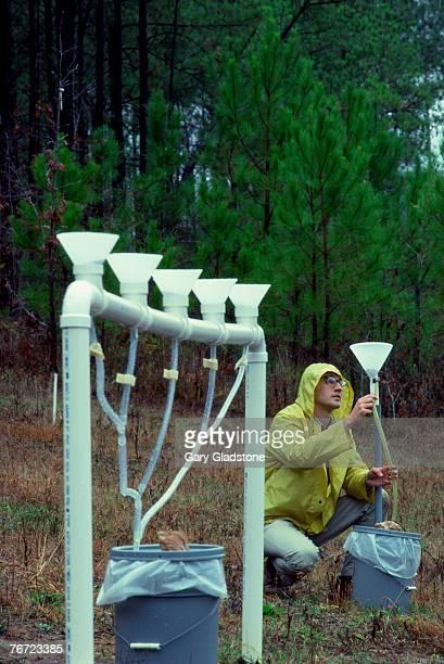 Man testing for acid rain