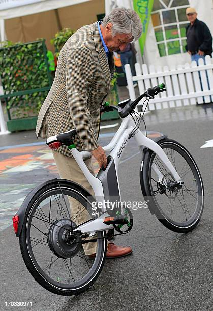 A man tests a ebike during the 2013 Velo City event in Vienna on June 11 2013 where participants promote and discuss on the cycling culture and...