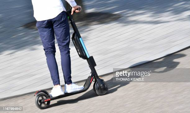 "Man tests an E-scooter during the event ""vision smart city"" at the Mercedes-Benz museum in Stuttgart, southern Germany, on September 14, 2019."