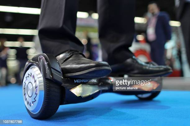 Man tests out a Hovertrax hoverboard produced by Razor at the International Toy Fair 2017 in Nuremberg, Germany, 01 January 2017. The world's largest...