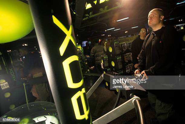 A man tests out a video game on Microsoft's Xbox game system at the Toys 'R' Us flagship store in Times Square