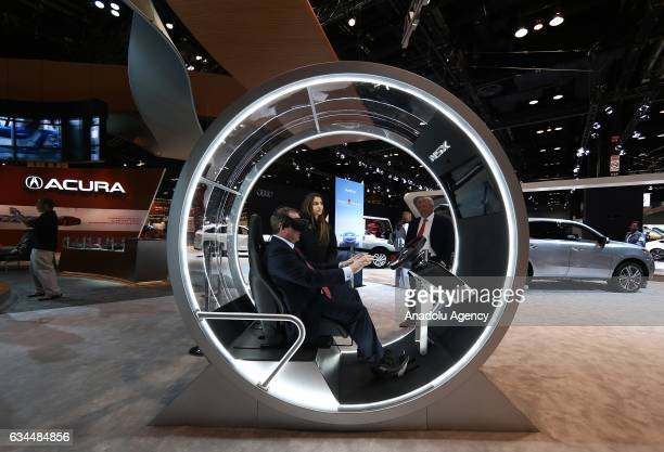 A man tests the unmanned vehicle system at the 109th Annual Chicago Auto Show at McCormick Place in Chicago Illionis USA on February 09 2017