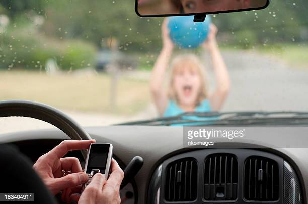 Man texting driving doesn't see girl running home in rain