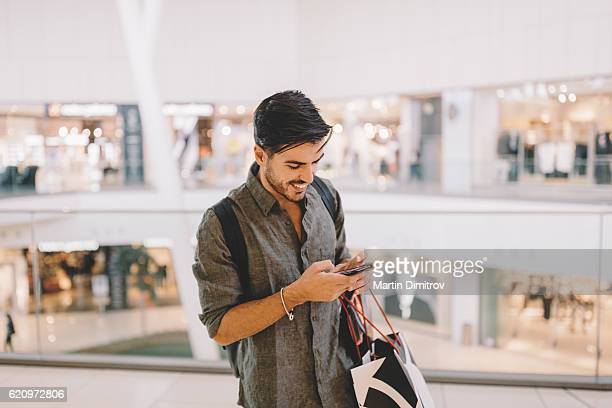 Man texting in the shopping mall