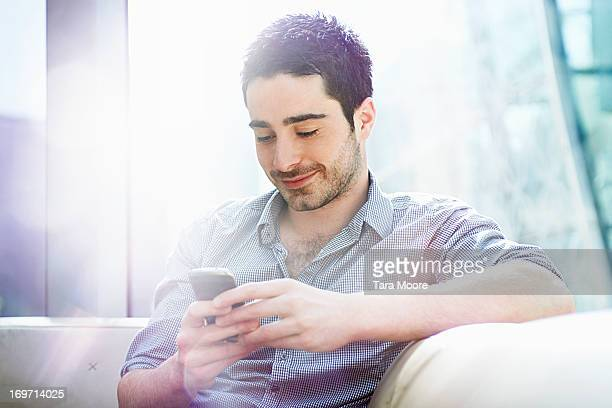 man texting on mobile in office
