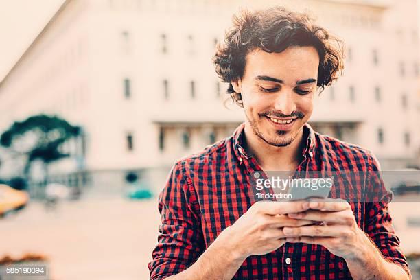 Man Texting Outdoor