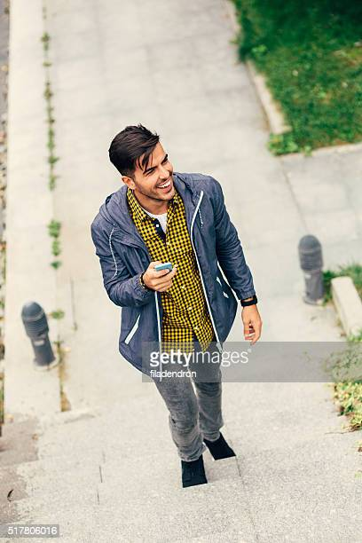 Man Texting While Climbing The Stairs