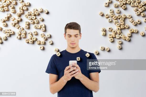 Man texting with the letter flying out of the phone