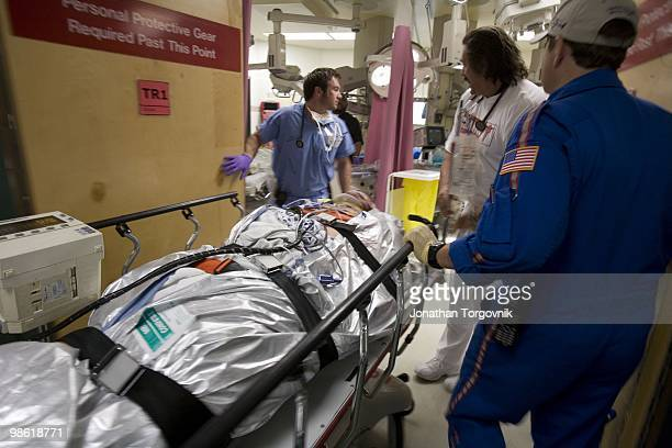 A man that was injured in a car accident arriving by helicopter and rushed to the trauma room for treatment at Grady memorial hospital on July 30...