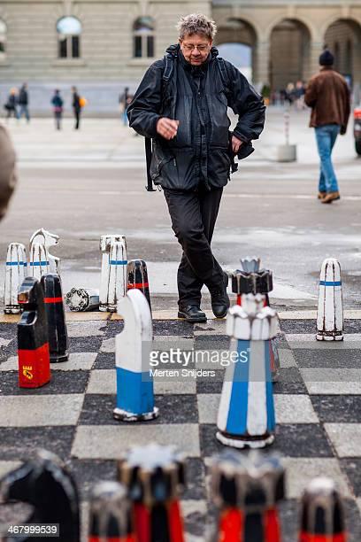Man thinking at street chess game