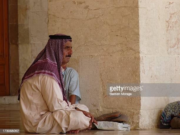 CONTENT] Man thinking at Umayyad Mosque Aleppo Syria
