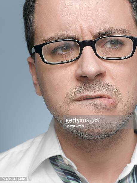 man thinking - biting lip stock photos and pictures
