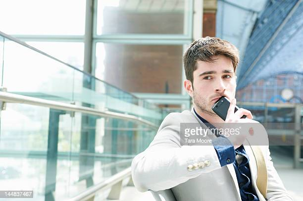 man thinking with mobile phone at station - newtechnology stock pictures, royalty-free photos & images