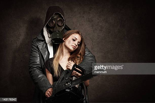 man threatening a young woman with chainsaw - female execution photos stock pictures, royalty-free photos & images
