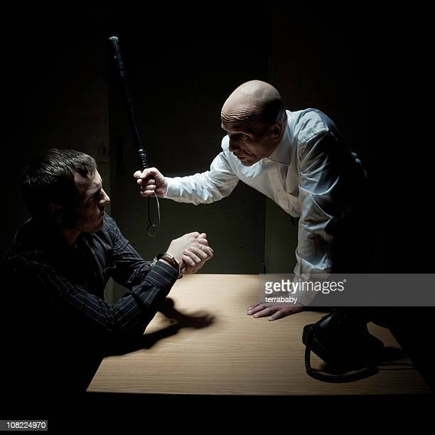 Man Threatening Handcuffed Victim with Club