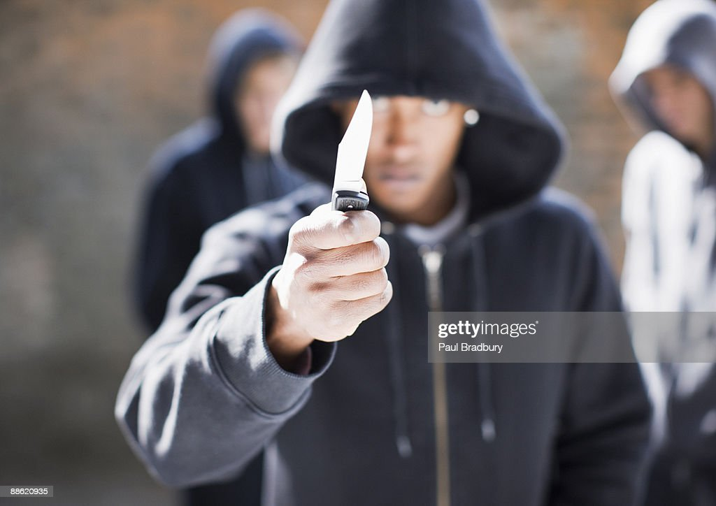Man threatening with pocket knife : Stock Photo