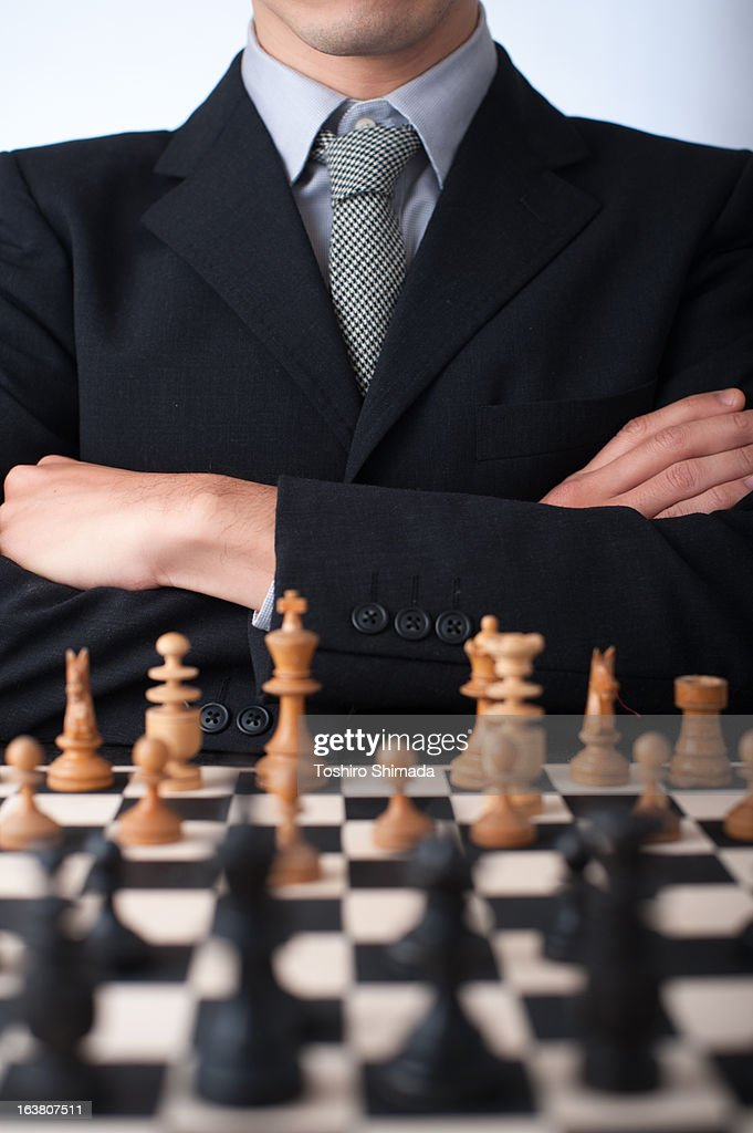 A man through the chess : Stock Photo