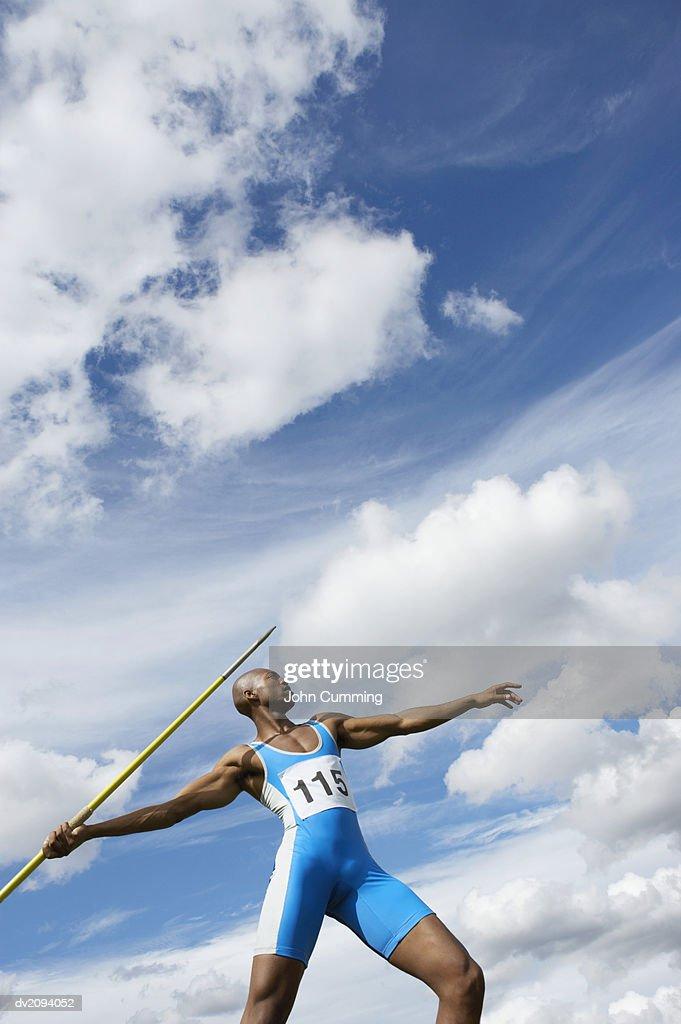 Man Throwing a Javelin : Stock Photo