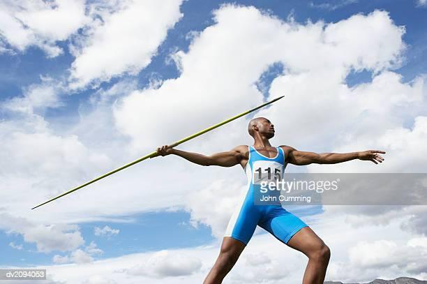 man throwing a javelin - やり投げ ストックフォトと画像