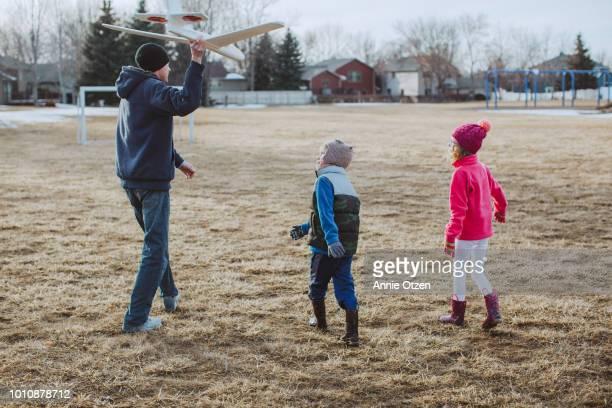 Man throwing a toy plane