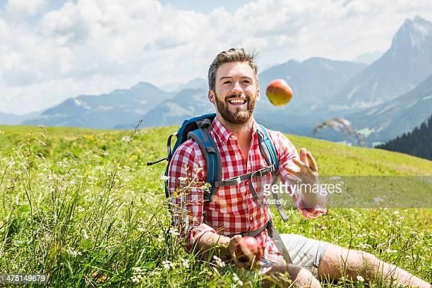Man throwing apple, Tyrol, Austria