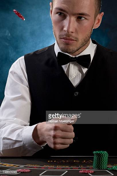 Man throwing gambling chip, portrait