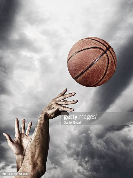 man throwing basketball in air, close-up of hands - shooting baskets stock pictures, royalty-free photos & images