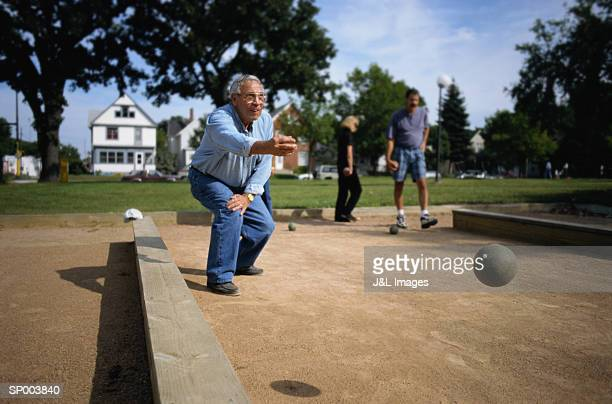 Man Throwing Bocce Ball