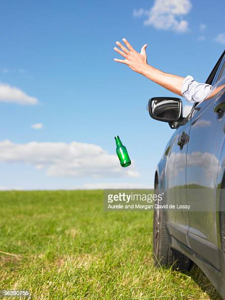 man throwing bottle away