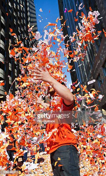 man throwing confetti during a celebration - parade stock pictures, royalty-free photos & images