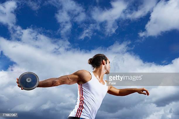 Man Throwing Discus