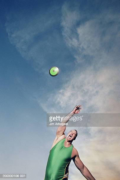 Man throwing discus, shouting