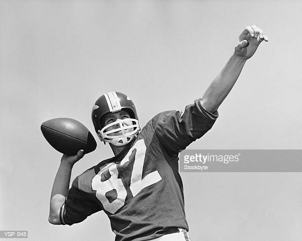 man throwing football - quarterback stock photos and pictures