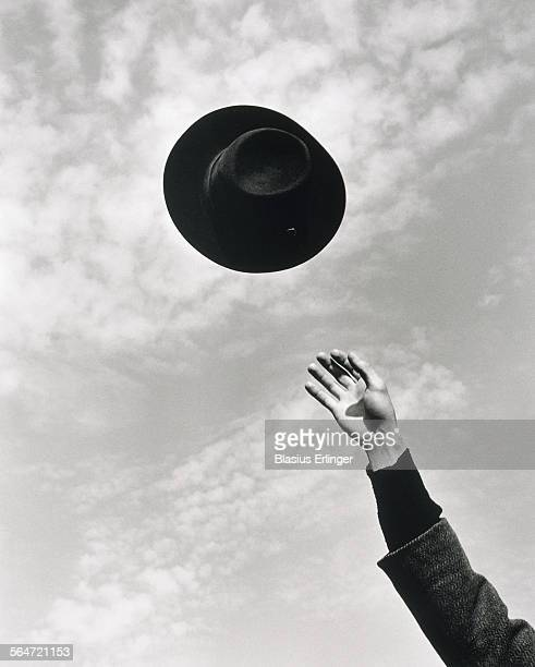 Man throwing hat in the air