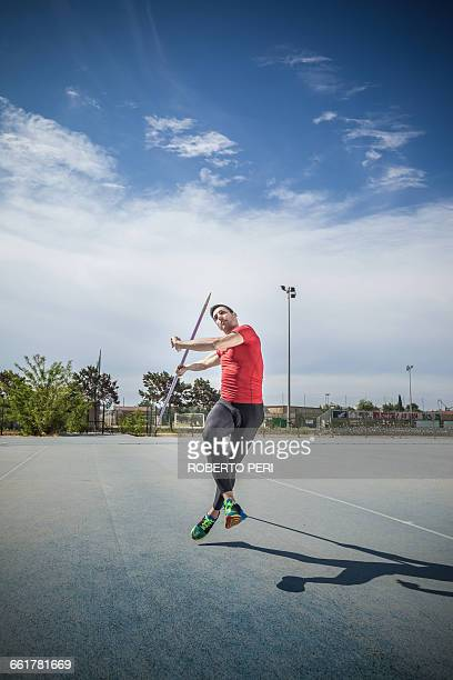 man throwing javelin in sports ground - javelin stock pictures, royalty-free photos & images