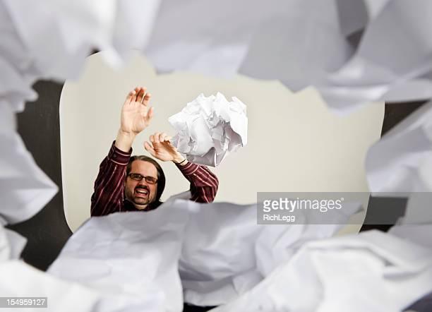 Man Throwing Paper Into Wastepaper Basket