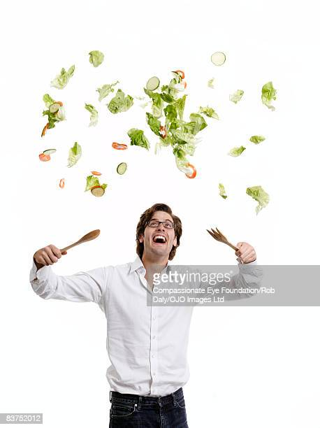 Man Throwing Salad