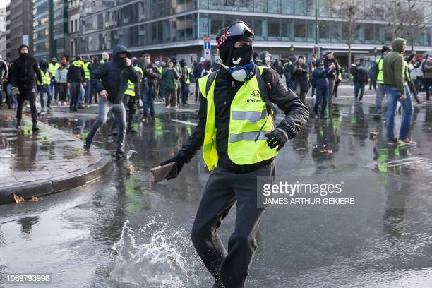 A man throws a brick during a protest of the yellow vests against the rising of the fuel and oil prices in Brussels on December 8 2018 The socalled...