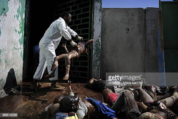 Image result for a man throwing the body of a dead child into a makeshift morgue at the general hospital in Port-au-Prince, Haiti, on Jan. 15, 2010.