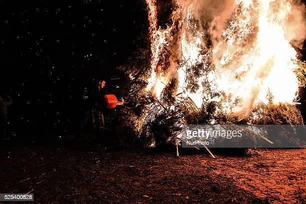 A man throws gas to the fire during Christmas Eve On Christmas Eve in the town of Florina in northern Greece and the surrounding villages a special...