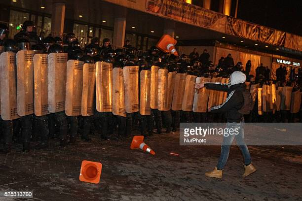 A man throws the Traffic Cones towards the police holding the cordon around concert hall Unknown people tried to disrupt Ani Lorak concert in Kiev...