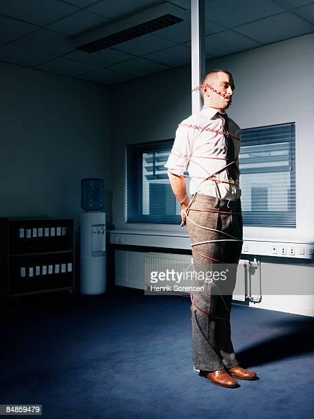 man tied up in his office. - mann gefesselt stock-fotos und bilder