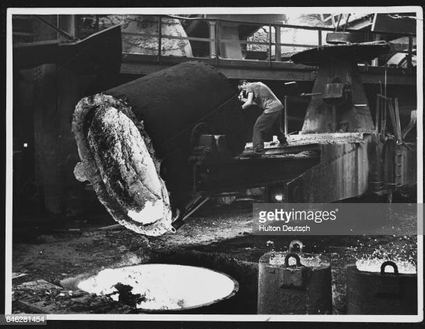 A man tips out the slag Hayange Moselle France