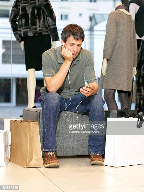 Man tired to wait his wife in the store