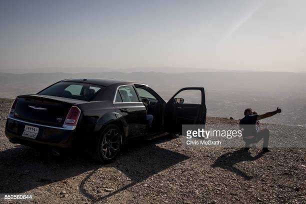 A man tkes a selfie on a mountain overlooking Sulaymaniyah city ahead of the upcoming referendum for independence of Kurdistan on September 23 2017...